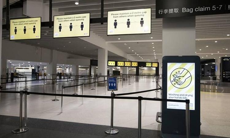 Khu vực nhận hành lý vắng bóng người ở sân bay quốc tế Auckland hồi đầu tháng này. Ảnh: RNZ.