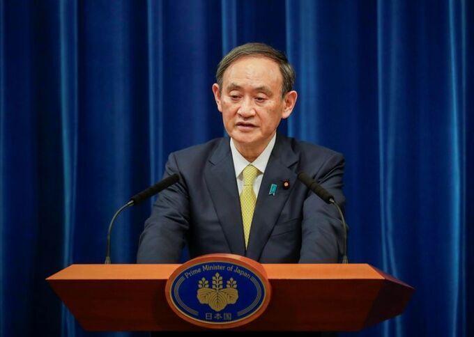 Thủ tướng Nhật Bản Yoshihide Suga trong một cuộc họp báo tại Tokyo tháng 12 năm ngoái. Ảnh: Reuters.