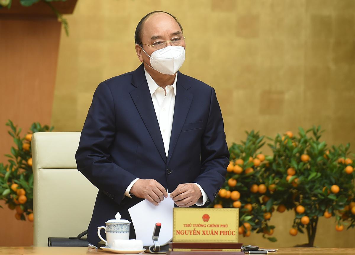 Thủ tướng Nguyễn Xuân Phúc chủ trì cuộc họp Thường trực Chính phủ về phòng chống COVID-19. Ảnh: VGP/Quang Hiếu.