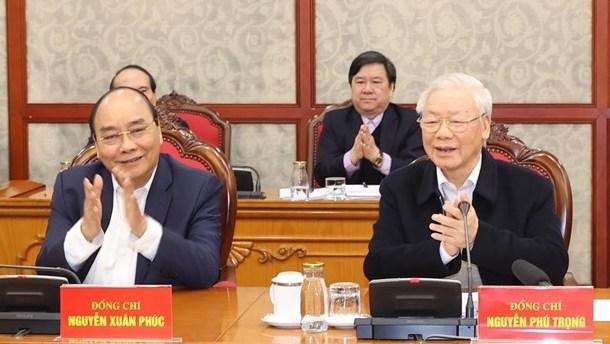 Tổng bí thư, Chủ tịch nước Nguyễn Phú Trọng và Thủ tướng Nguyễn Xuân Phúc tại phiên họp sáng 18/2. Ảnh: TTXVN