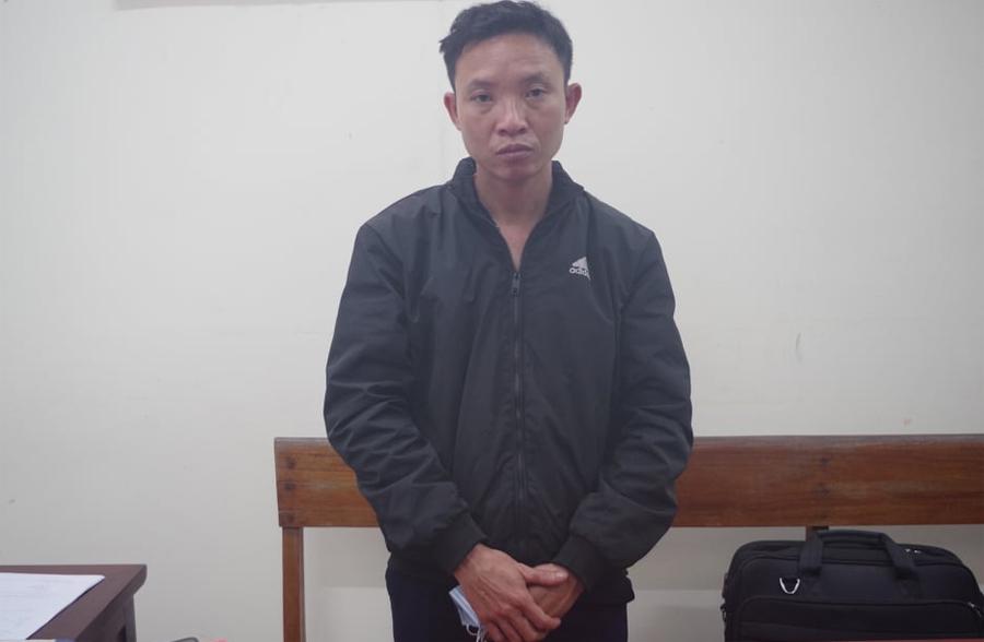 Lê Quang Thành tại cơ quan điều tra. Ảnh: Công an cung cấp