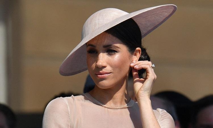 Công nương Meghan Markle dự sự kiện của hoàng gia Anh tại Buckingham Palace, London năm 2018. Ảnh: AFP.