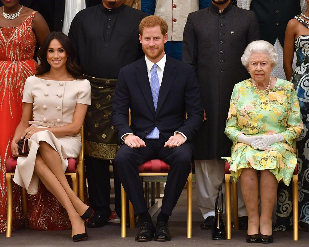 Vợ chồng Harry - Meghan và Nữ hoàng Anh tại một sự kiện ở London hồi tháng 6/2018. Ảnh: AFP.