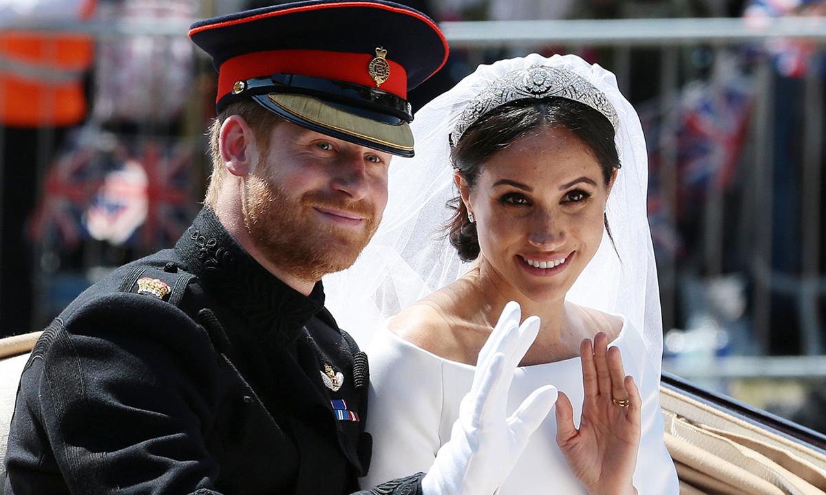 Hoàng tử Harry và Meghan Markle tại lễ rước ở lâu đài Windsor tháng 5/2018. Ảnh: AFP.