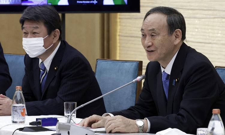 Thủ tướng Nhật Yoshihide Suga tại cuộc họp ở dinh thủ tướng hôm 12/3. Ảnh: AFP.