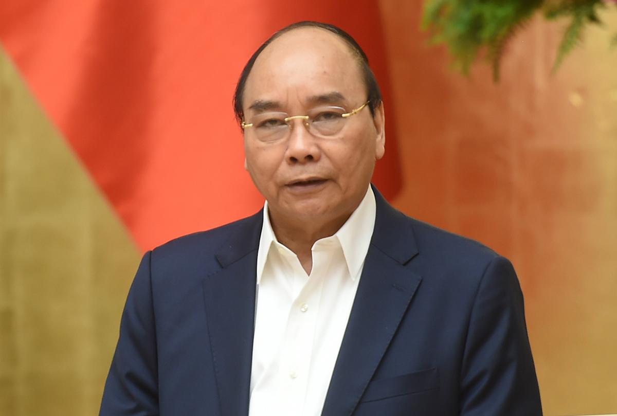 Thủ tướng Nguyễn Xuân Phúc chủ trì họp Thường trực Chính phủ với các địa phương về phòng, chống Covid-19, sáng 17/3. Ảnh: VGP