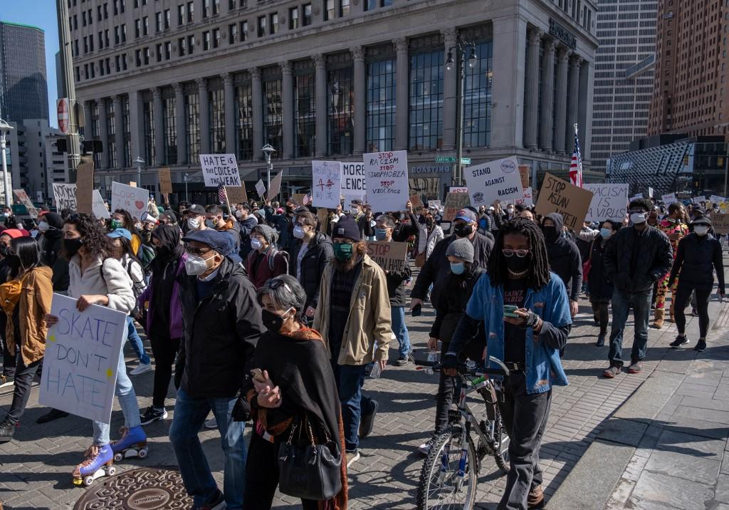Người biểu tình tuần hành tại Michigan ngày 27/3. Ảnh: AFP.