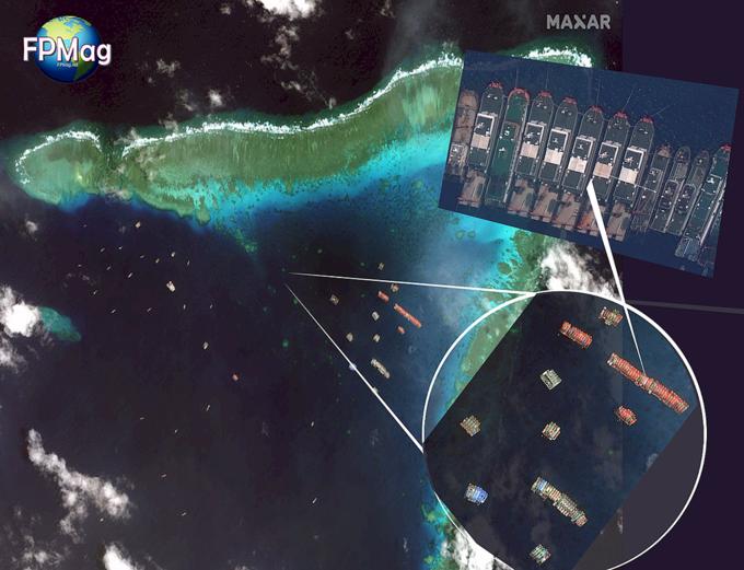 Đội hình tàu Trung Quốc neo đậu tại bãi đá gần đảo Sinh Tồn Đông của Việt Nam. Ảnh: Maxar.