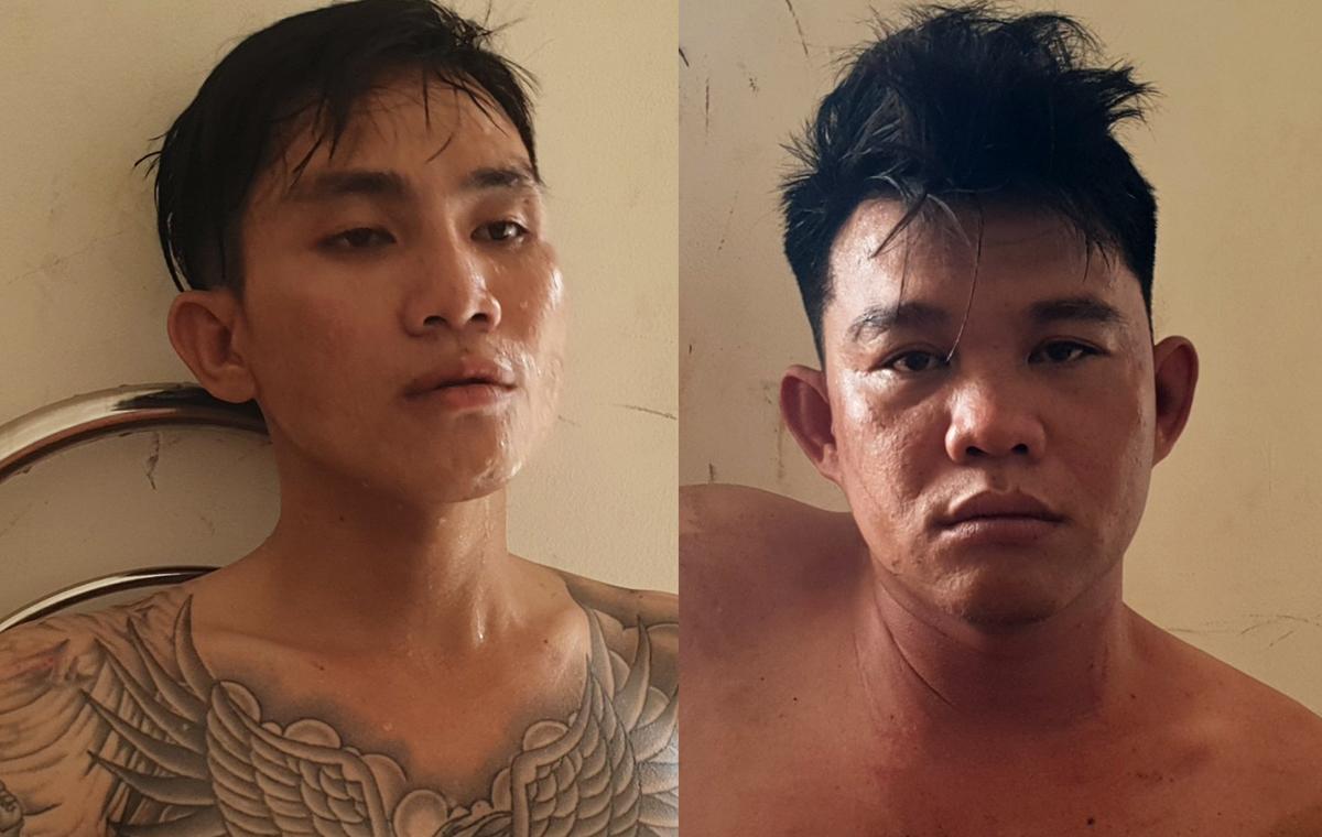 Đò (phải) và Quý tại Công an huyện Châu Đức. Ảnh: Hắc Minh.