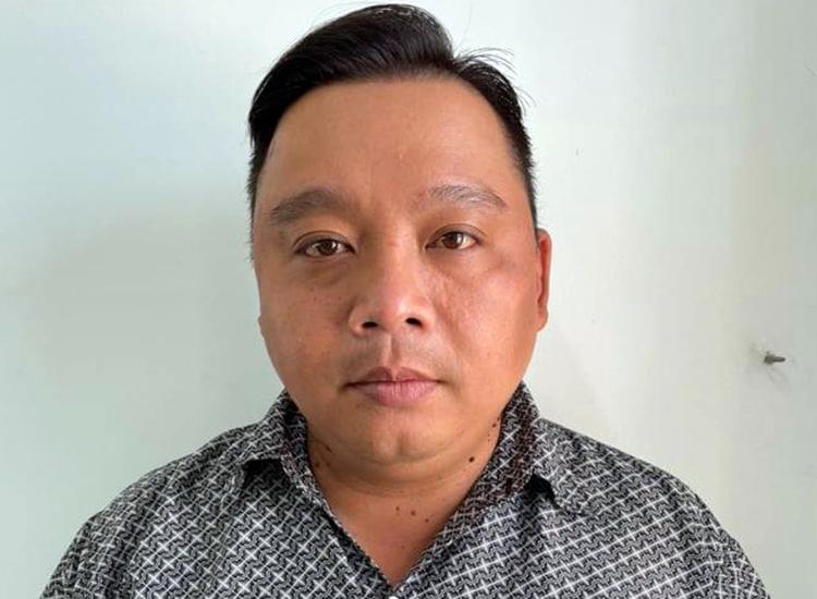 Lý Quang Thái tại cơ quan điều tra. Ảnh: Công an cung cấp