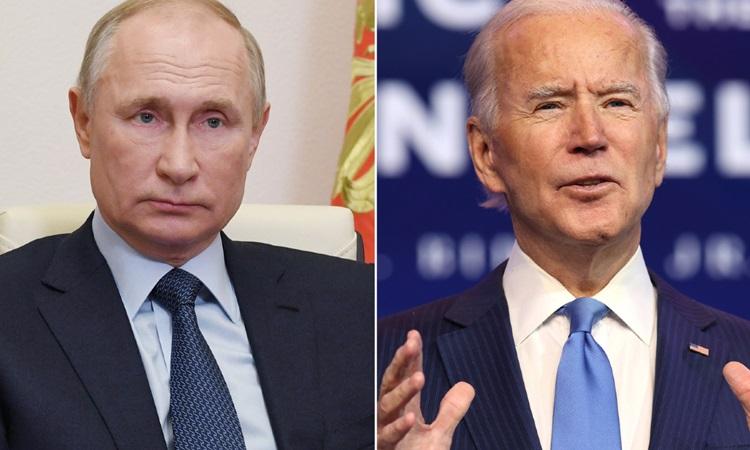Tổng thống Nga Vladimir Putin (trái) và Tổng thống Mỹ Joe BIden. Ảnh: AFP.