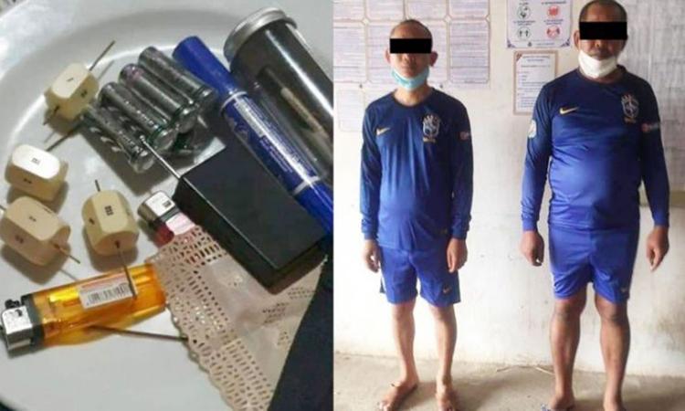 Hai nhà sư cùng các tang vật bị cảnh sát tỉnh Kampong, Campuchia thu giữ hôm 18/4. Ảnh: Phnom Penh Post.