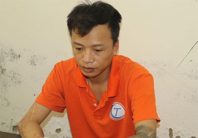 Hoàng Trần Cường tại cơ quan điều tra. Ảnh: CA