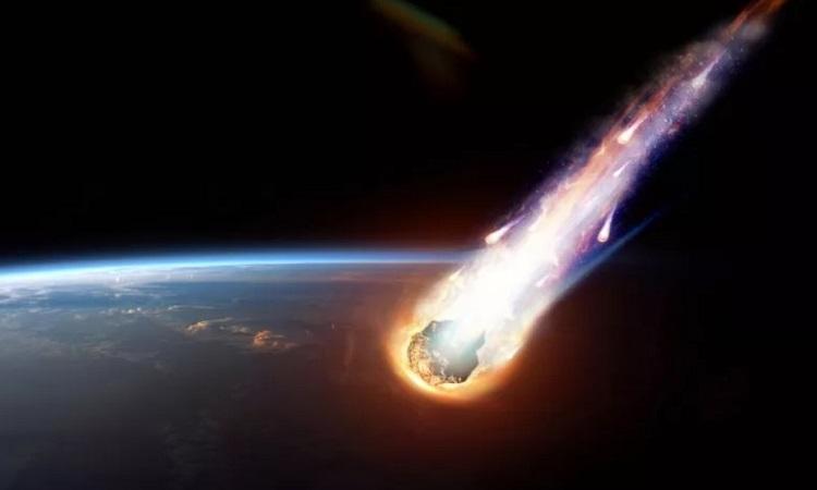 Mô phỏng tiểu hành tinh bay về phía Trái Đất bốc cháy trong khí quyển. Ảnh: iStock.