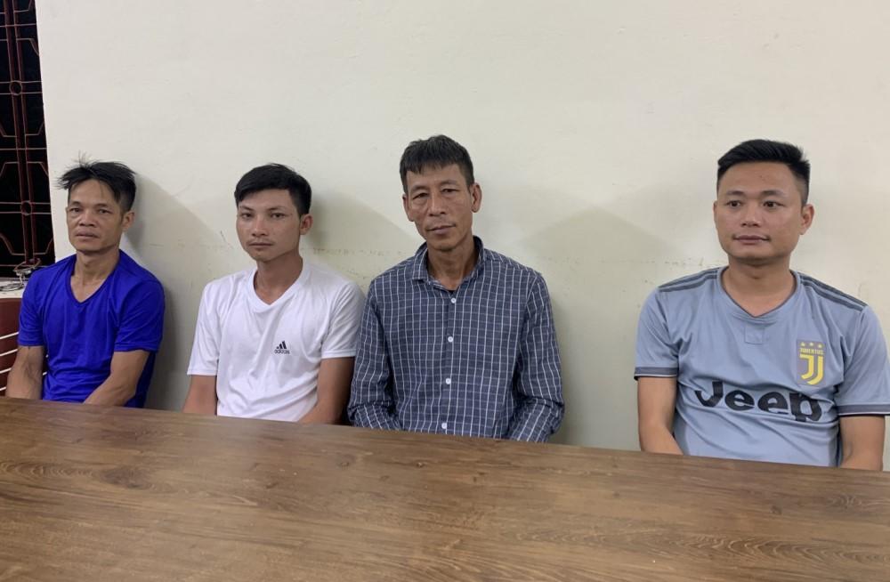 Từ trái sang là Hoàng, Sinh, Đường, Phúc tại cơ quan điều tra. Ảnh: Huy Hoàng
