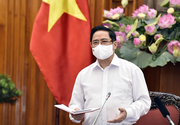 Thủ tướng Phạm Minh Chính chủ trì họp trực tuyến với 63 tỉnh, thành về phòng chống Covid-19, chiều 7/5. Ảnh: VGP