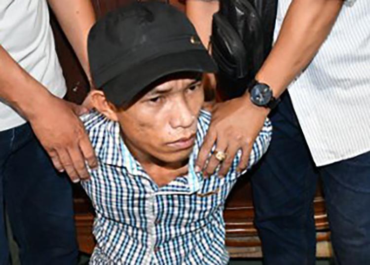 Sơn Thanh Tuấn khi bị bắt giữ. Ảnh: Công an cung cấp