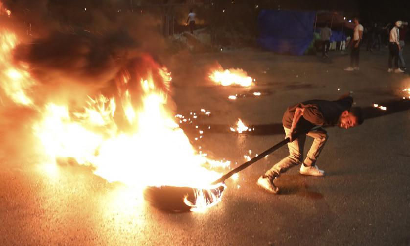 Người dân Palestine trong cuộc biểu tình chống Israel tại Bờ Tây hôm 12/5. Ảnh: AFP.