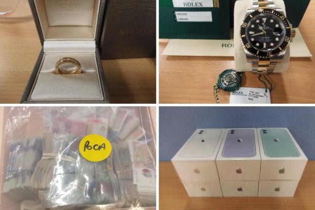 Tang vật được thu giữ gồm nhiều tiền mặt và các xa xỉ phẩm. Ảnh: Metropolitan Police