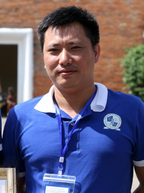 Thầy Lê Thịnh trong đoàn tham dự cuộc thi Khoa học kỹ thuật cho học sinh trung học năm 2018 của Bộ Giáo dục và Đào tạo tổ chức tại Lâm Đồng. Ảnh: Mạnh Tùng.