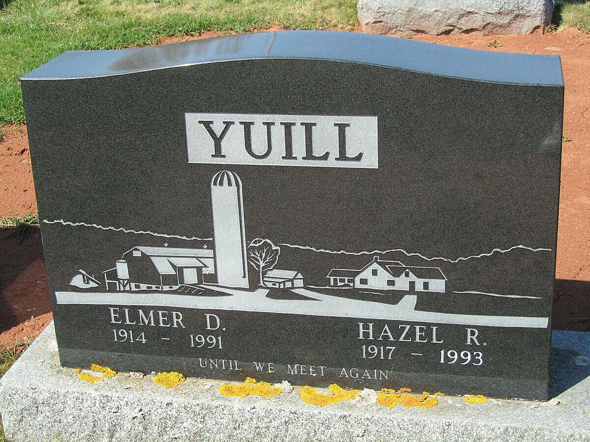 Elmer Yuill và vợ được chôn cùng nhau, trên bia mộ khắc hình ảnh trang trại gia đình. Ảnh: findagrave.com