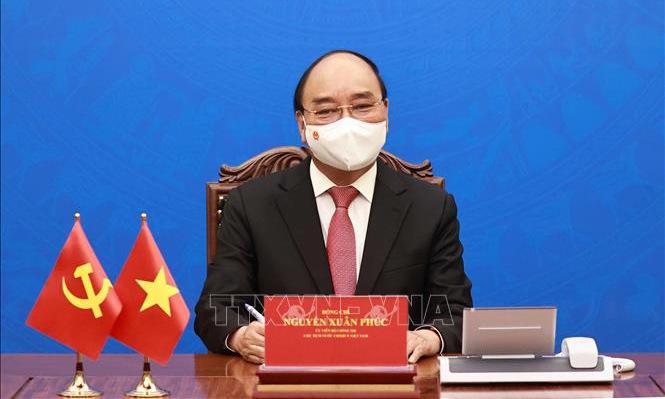 Chủ tịch nước Nguyễn Xuân Phúc trong cuộc điện đàm hôm nay. Ảnh: TTXVN.