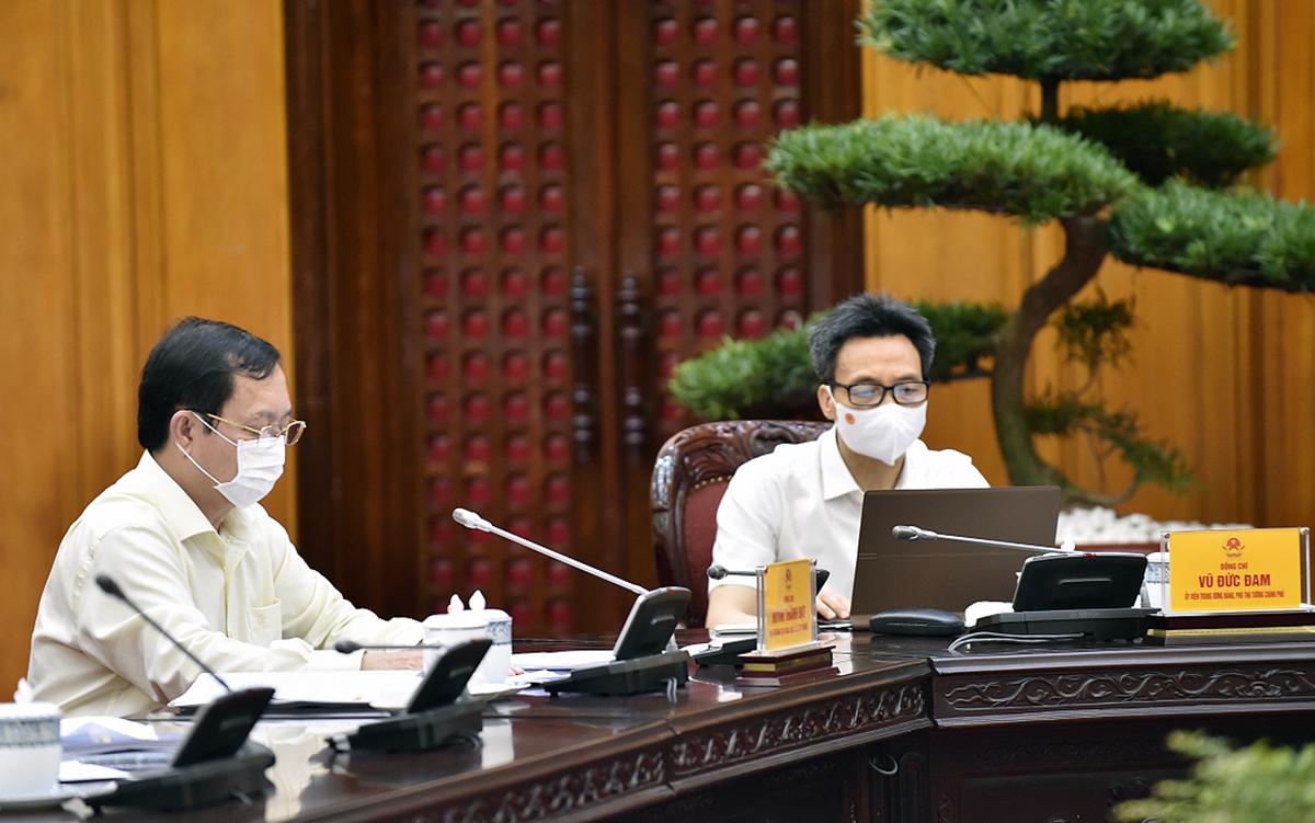 PTT Vũ Đức Đam (phải) và Bộ trưởng Huỳnh Thành Đạt (trái) tại buổi làm việc sáng 27/5. Ảnh: Nhật Bắc/VGP.