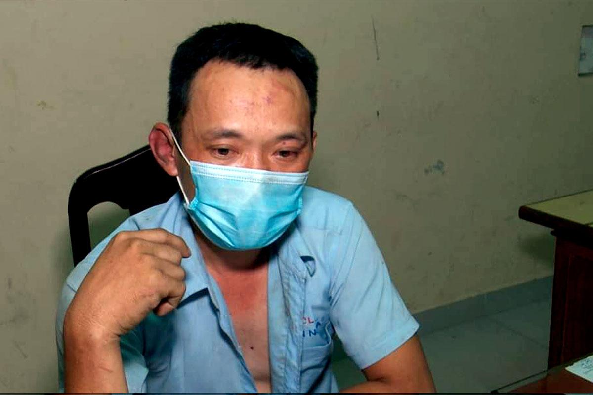 Nguyễn Quốc Tuấn tại cơ quan công an. Ảnh: Công an cung cấp.