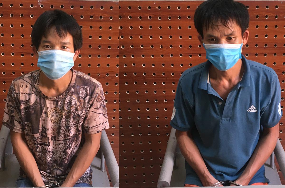 Nguyễn Văn Hoàng (phải) và Nguyễn Văn Hiến tại cơ quan điều tra. Ảnh: Công an cung cấp.
