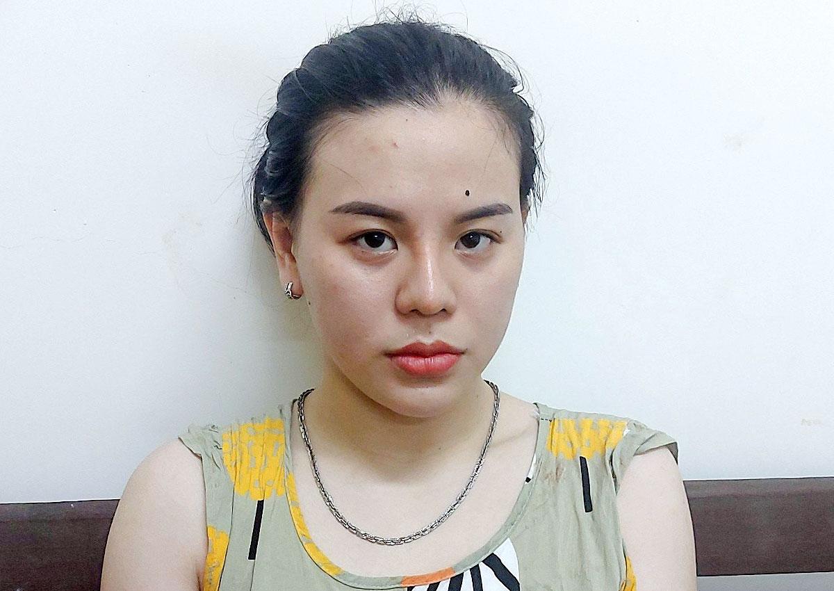 Lê Thị Thảo Linh tại cơ quan công an. Ảnh: Nam Em.