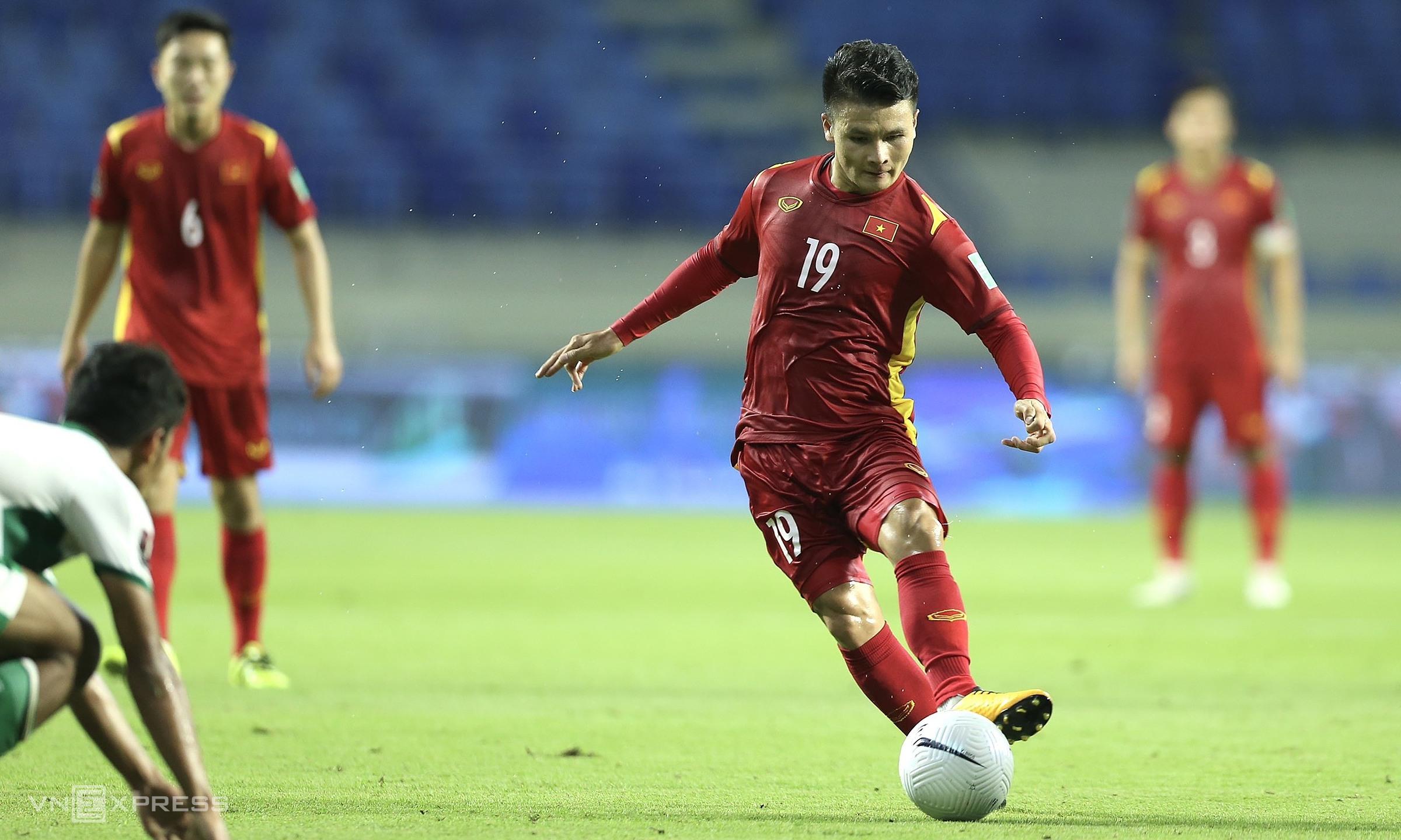 """กว๋างไห่ได้รับใบเหลืองสองใบในรอบคัดเลือกรอบที่สองของฟุตบอลโลก 2022 และถูกระงับการแข่งขันนัดต่อไปกับมาเลเซียในตอนเย็นของวันที่ 11 มิถุนายน  ภาพถ่าย: """"Lam Thua ."""""""
