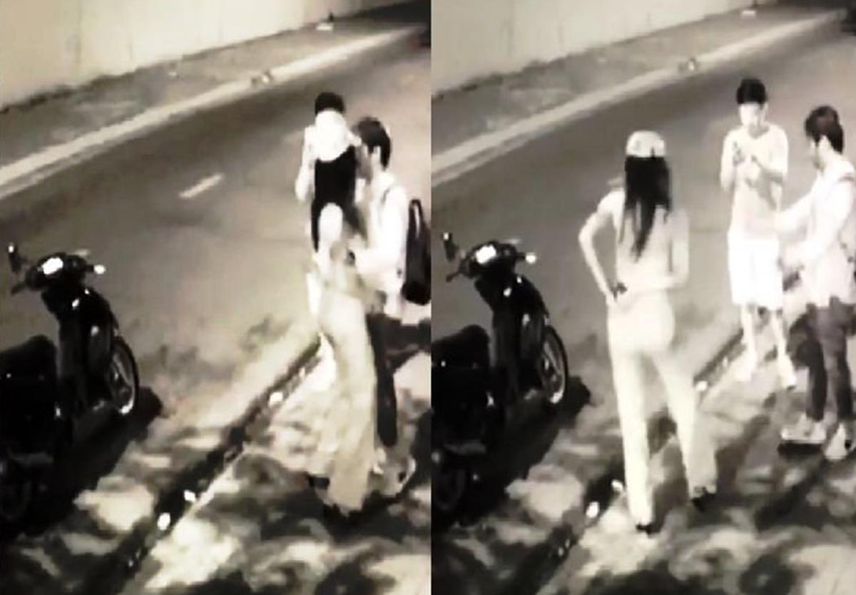 Nghi phạm dừng xe, áp sát nạn nhân rồi lấy điện thoại giấu sau cạp quần. Ảnh: Phòng Cảnh sát Hình sự cung cấp.