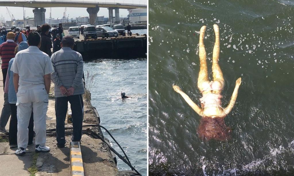 Người dân thành phố Hachinohe đứng xem vụ trục vớt búp bê tình dục. Ảnh: Twitter/Natsuki Tanaka.