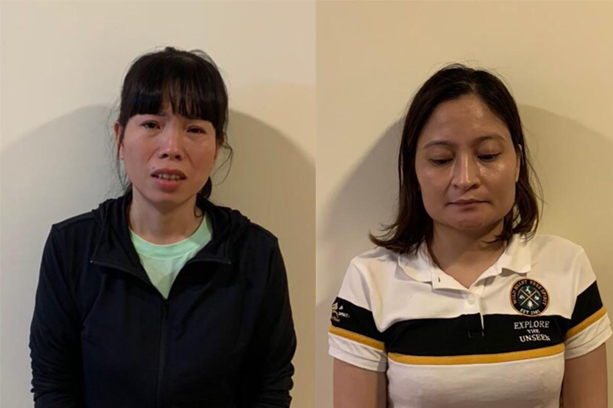 Bị can Cao Thị Minh Thuận (trái) và Hoàng Thị Ánh Vân tại cơ quan điều tra. Ảnh: Bộ Công an.