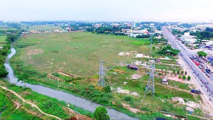 Dự án khu dân cư Hòa Lân đến nay vẫn còn là khu đất trống. Ảnh: Công ty Kim Oanh.