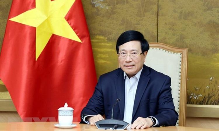 Phó thủ tướng Phạm Bình Minh điện đàm với Cố vấn An ninh Quốc gia Mỹ Jake Sullivan hôm nay. Ảnh: TTXVN.