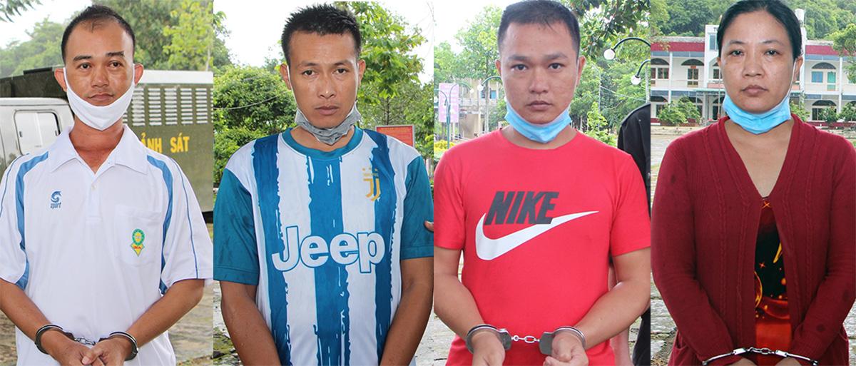Từ trái sang, Nguyễn Văn Lê, Phạm Tấn Lộc, Nguyễn Hữu Phước, Mai Thị Ngọc Phấn tại cơ quan công an. Ảnh: An Phú