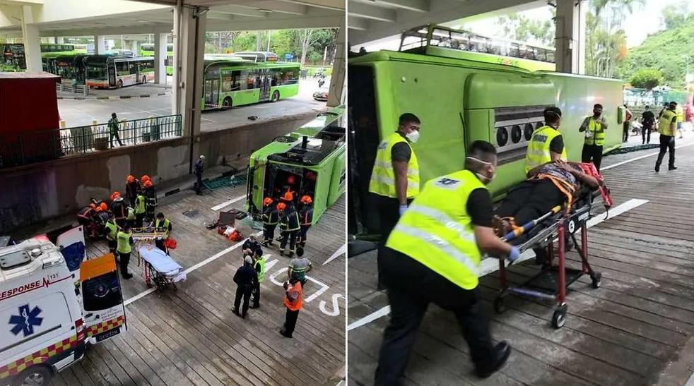 Một trong hai xe buýt đâm nhau húc vỡ hàng rào và rơi xuống đường phía dưới. Tài xế bị thương ở ngực khi rơi khỏi xe. Ảnh: SCDF