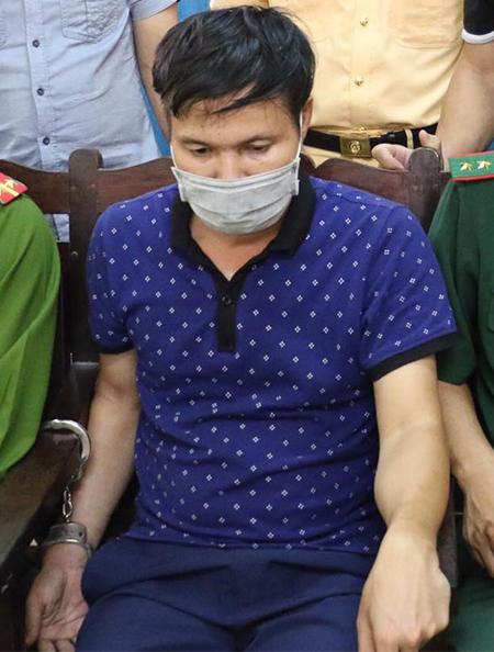 Phạm Xuân Tài sau khi bị bắt. Ảnh: CTV