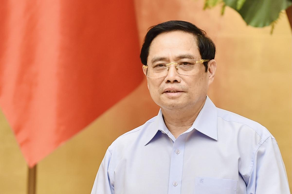 Thủ tướng Phạm Minh Chính chủ trì họp về sản xuất vaccine trong nước, chiều 23/7. Ảnh: Nhật Bắc