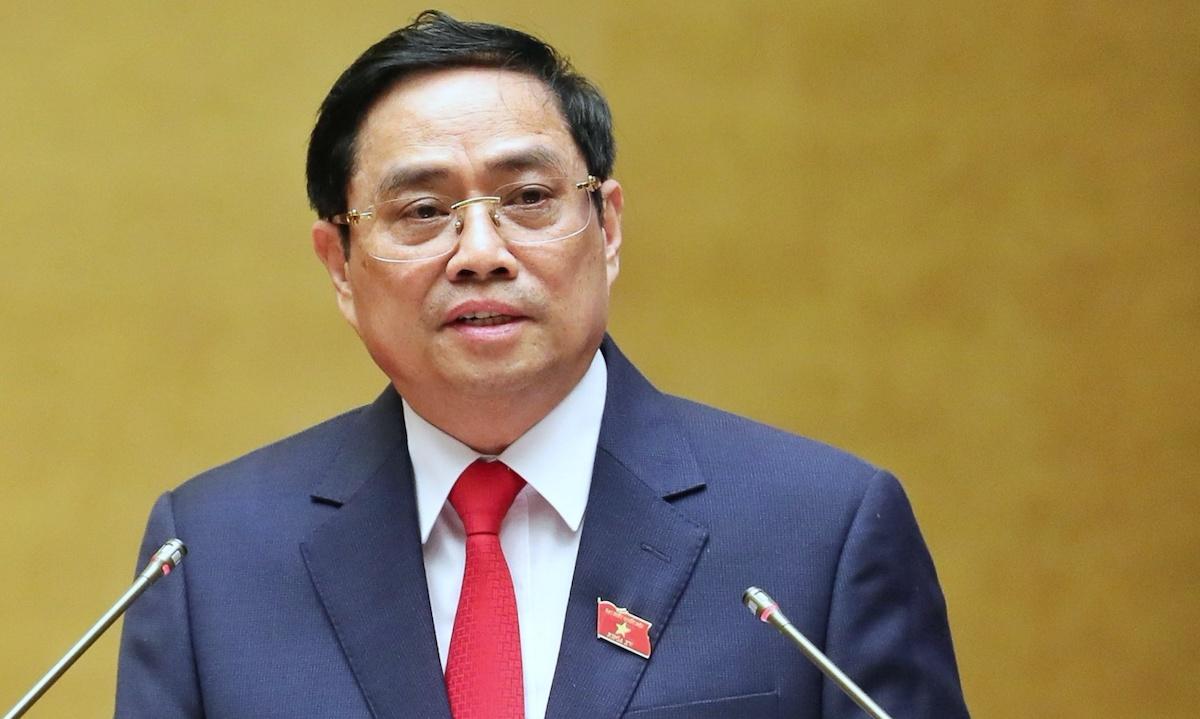 Thủ tướng Phạm Minh Chính trình cơ cấu số lượng thành viên Chính phủ nhiệm kỳ Quốc hội khóa XV, chiều 26/7. Ảnh: Giang Huy