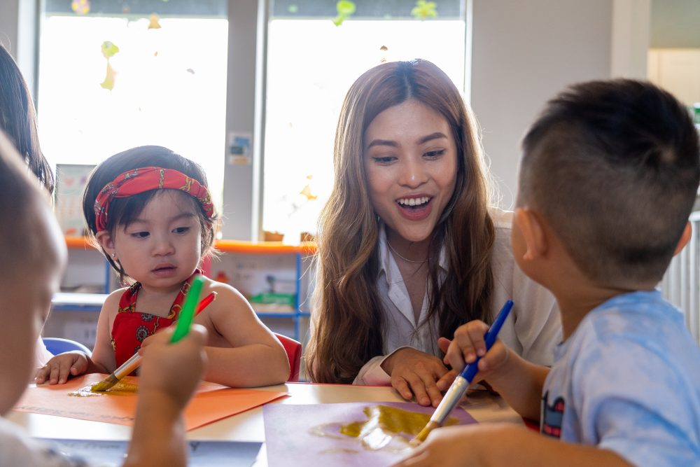 Ngoc Ho during a drawing lesson at Dino Land Academy.  Photo: Lucio Vasquez.