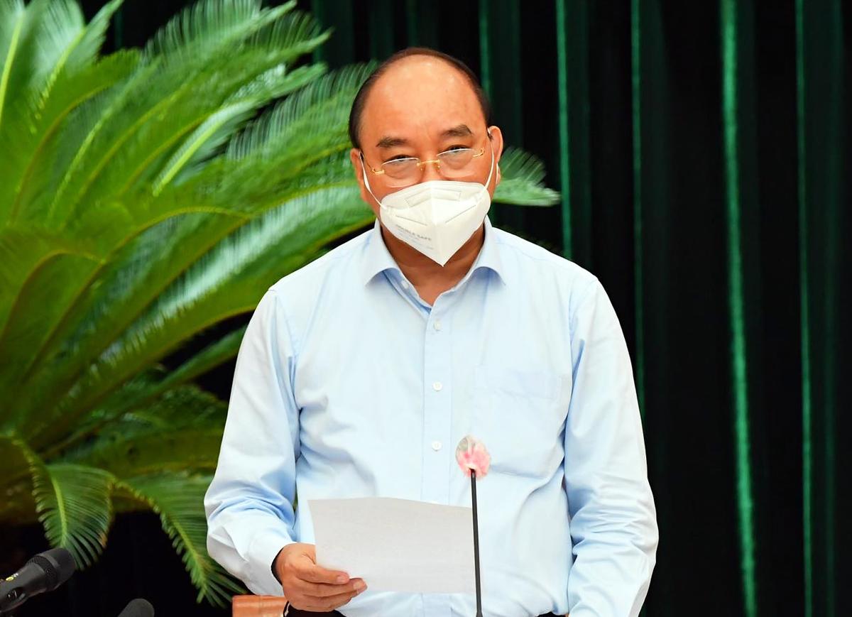 Chủ tịch nước Nguyễn Xuân Phúc phát biểu chỉ đạo tại buổi làm việc, sáng 30/7. Ảnh: Việt Dũng.