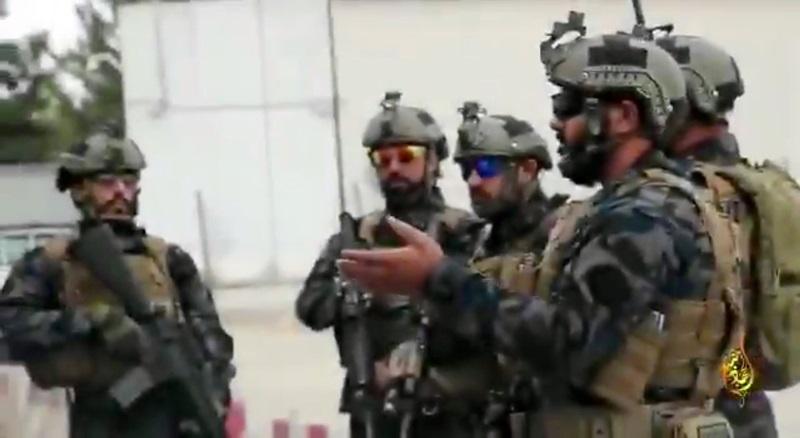 Lính Taliban đeo loại kính phản quang rất được quân đội Mỹ ưa chuộng  trong video tuyên truyền ngày 20/8. Ảnh: Twitter/Al Hijrat TV.