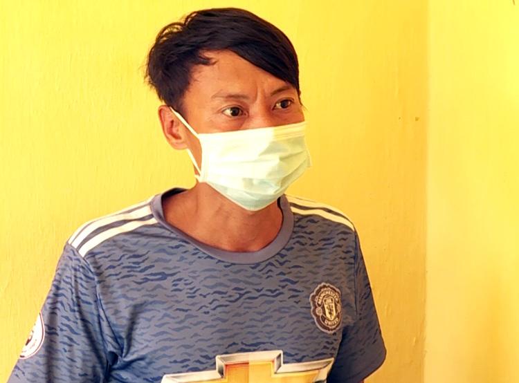 Phạm Ming Nhật Trung tại cơ quan điều tra. Ảnh: Công an cung cấp