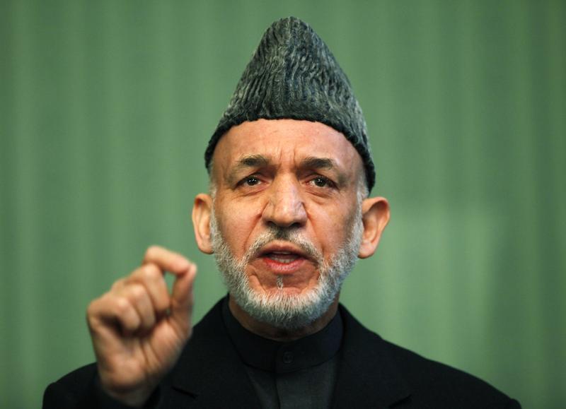 Cựu tổng thống Afghanistan Hamid Karzai phát biểu trong một cuộc họp báo ở Kabul vào tháng 1/2014. Ảnh: Reuters.