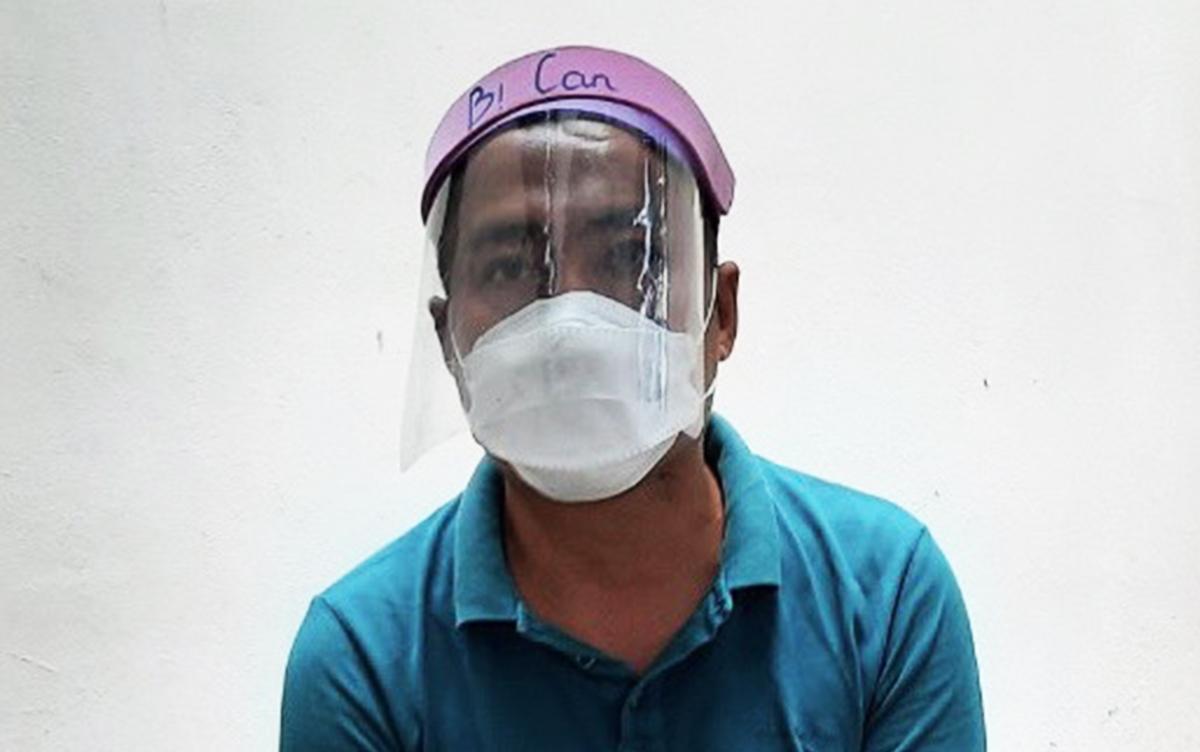 Trần Quang Minh tại Công an thị xã Phú Mỹ. Ảnh: Quang Bình