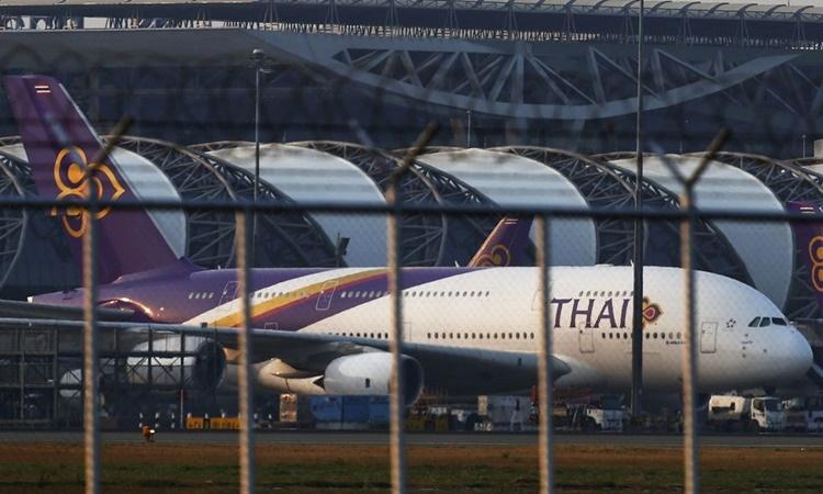 Máy bay của hãng hàng không Thai Airways tại sân bay Suvarnabhumi của Bangkok hồi tháng 2/2014. Ảnh: Reuters.
