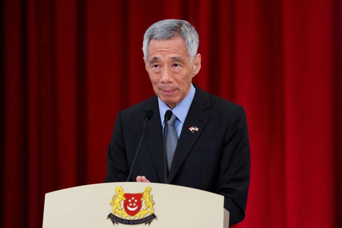 Thủ tướng Singapore Lý Hiển Long trong một cuộc họp báo hôm 23/8. Ảnh: Reuters.