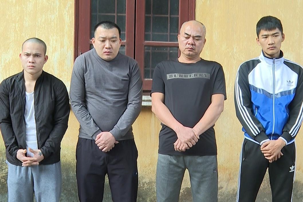 Từ trái qua, các bị can Đặng Văn Thêm, Nguyễn Ngọc Sơn, Nguyễn Văn Ích, Nguyễn Sinh Mạnh. Ảnh: Kim Chung